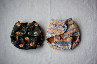 Buttons newborn cover (left) and OS cover (right) on their smallest settings.
